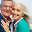 Romantic Senior Couple Hugging On Beach — Stock Photo
