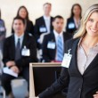 Businesswoman Delivering Presentation At Conference — Stock Photo #24654953