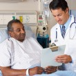 Doctor Explaining Consent Form To Senior Patient — Stock Photo #24655095