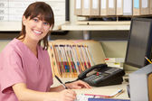 Nurse Working At Nurses Station — Stock Photo