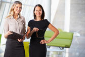 Businesswomen Having Informal Meeting In Modern Office — Stock Photo