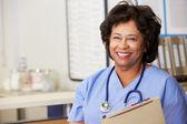 Female Nurse At Nurses Station — Stock Photo