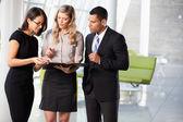 Businesspeople Having Informal Meeting In Modern Office — Stock Photo