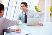 Two Businessmen Having Meeting Around Table In Modern Office — Stock Photo