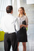 Businessman And Businesswoman Having Meeting In Office — Stock Photo