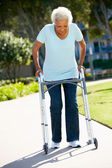 Senior Woman With Walking Frame — Stock Photo
