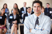 Businessman Delivering Presentation At Conference — Stock Photo