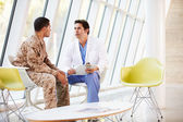 Doctor Counselling Soldier Suffering From Stress — Stock Photo