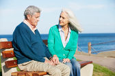 Senior Woman Comforting Depressed Husband Sitting On Bench — Stock Photo