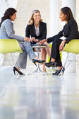 Three Businesswomen Meeting Around Table In Modern Office — Stock Photo