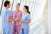 Medical Staff Talking In Hospital Corridor With Digital Tablet — Stock Photo