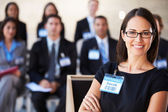 Businesswoman Delivering Presentation At Conference — Photo