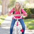 Stock Photo: Girl Wearing Rucksack Cycling To School