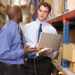 Two Businessmen With Laptop In Warehouse — Lizenzfreies Foto