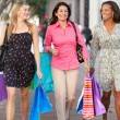 Stock Photo: Group Of Women Carrying Shopping Bags On City Street