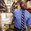 Man Pulling Pallet In Warehouse — Stock Photo