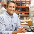 Businessman Working At Desk In Warehouse — Stock Photo