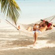 Romantic Couple Relaxing In Beach Hammock — Stock Photo #25045461