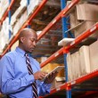 Stock Photo: Businessman With Clipboard In Warehouse