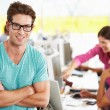 Stock Photo: Portrait Of Man Standing In Busy Creative Office