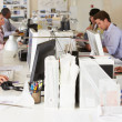 Team Working At Desks In Busy Office — Stock Photo #25045499