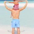 Rear View Of Father Carrying Daughter On Beach Holiday — Stock Photo
