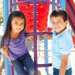 Boy And Girl On Climbing Frame In Park — Foto de Stock