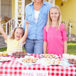 Family Running Charity Bake Sale - Stock Photo
