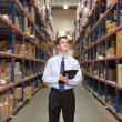 Manager In Warehouse With Clipboard - Stok fotoğraf