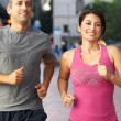 Portrait Of Male And Female Runners On Urban Street - Stock Photo