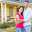 Couple Standing Outside Suburban Home — Stock Photo