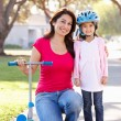 Mother Teaching Daughter To Ride Scooter — Foto Stock