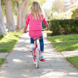 Girl Riding Bike Along Path - Stock Photo
