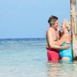 Senior Romantic Couple Standing In Beautiful Tropical Sea — Stock Photo