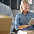 Manager Using Tablet Computer In Distribution Warehouse — Stock Photo