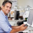 Man Using Mobile Phone At Desk In Busy Creative Office — Stok fotoğraf