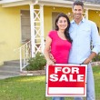 Couple Standing By For Sale Sign Outside Home — Stock Photo #25045759