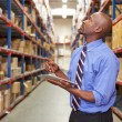 Businessman With Clipboard In Warehouse — Stock Photo