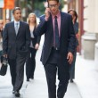 Businessman Outside Office On Mobile Phone - Stock Photo