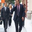 zakenman buiten kantoor op mobiele telefoon — Stockfoto #25045859