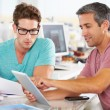 Two Men Using Tablet Computer In Creative Office — Stock Photo