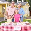 Family Running Charity Bake Sale — Stock Photo #25045913