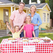 Stock Photo: Family Running Charity Bake Sale
