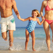 Family Having Fun In Sea On Beach Holiday — Stock Photo