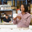 Manager Checking Goods On Production Line — Stock Photo #25045987
