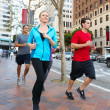 Portrait Of Male And Female Runners On Urban Street — Stockfoto