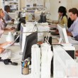 Stock Photo: Team Working At Desks In Busy Office