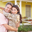 Husband Welcoming Wife Home On Army Leave - Stock Photo