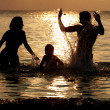 Silhouette Of Family Having Fun In Sea On Beach Holiday — Stock fotografie