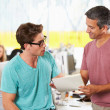 Royalty-Free Stock Photo: Two Men Meeting In Creative Office